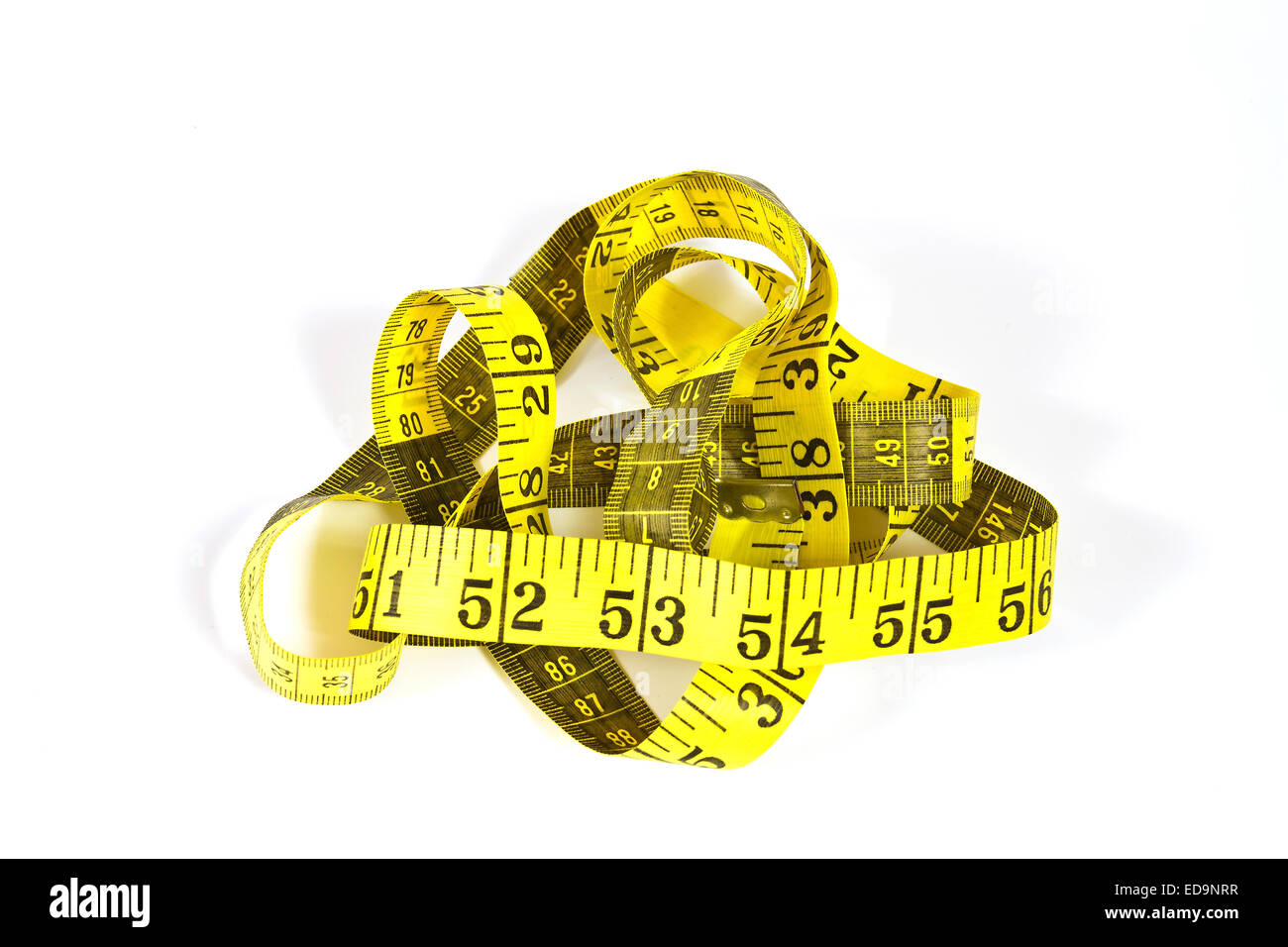 Tape measure with inch and centimeter scale on a white background - Stock Image
