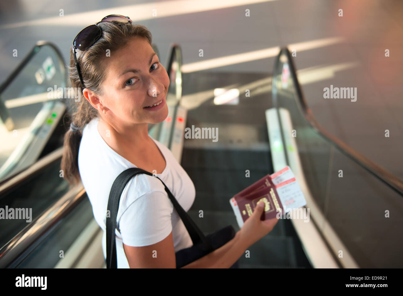 girl with a passport and a ticket is sent to board the aircraft - Stock Image