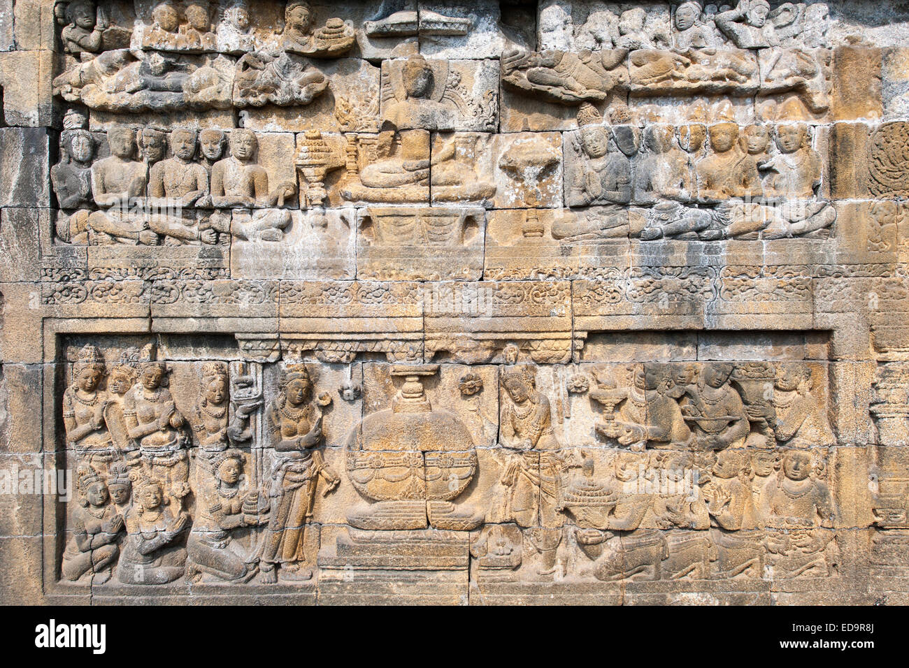 Karmawibhangga bas reliefs (160 of them) carved in the stone of Borobodur, a 9th-century Buddhist Temple in Magelang, - Stock Image