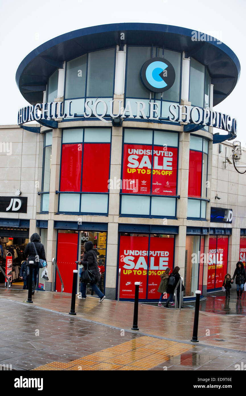 January sales signs up in windows in shops to promote it. Brighton Churchill Square shopping centre - Stock Image