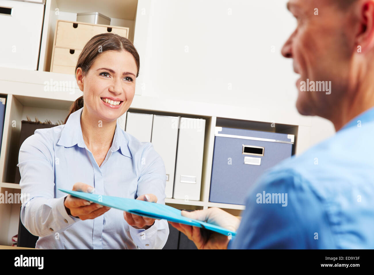 Man At Job Application Interview In Office Handing Out Rsum Stock