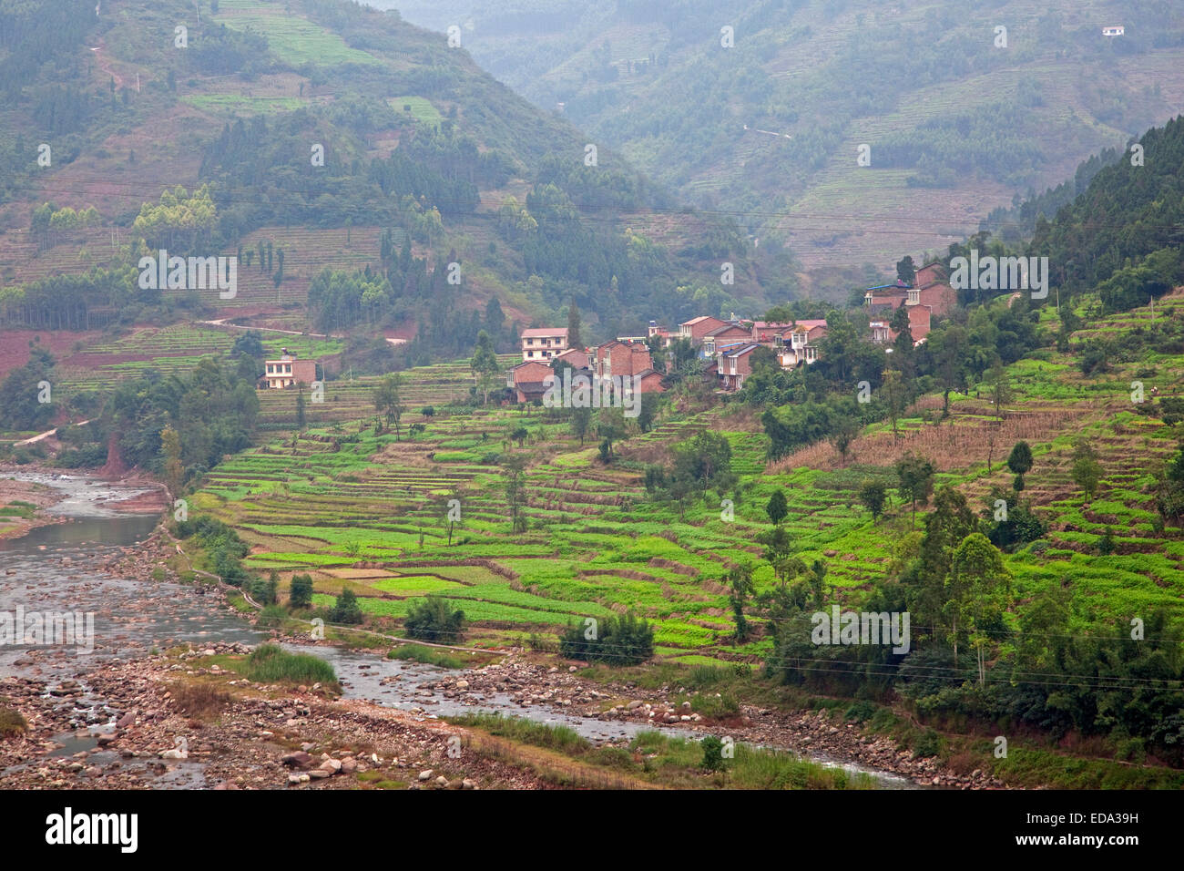 Rural village and terraced rice paddies in southern China, Zhaotong District, Yunnan Province, China - Stock Image