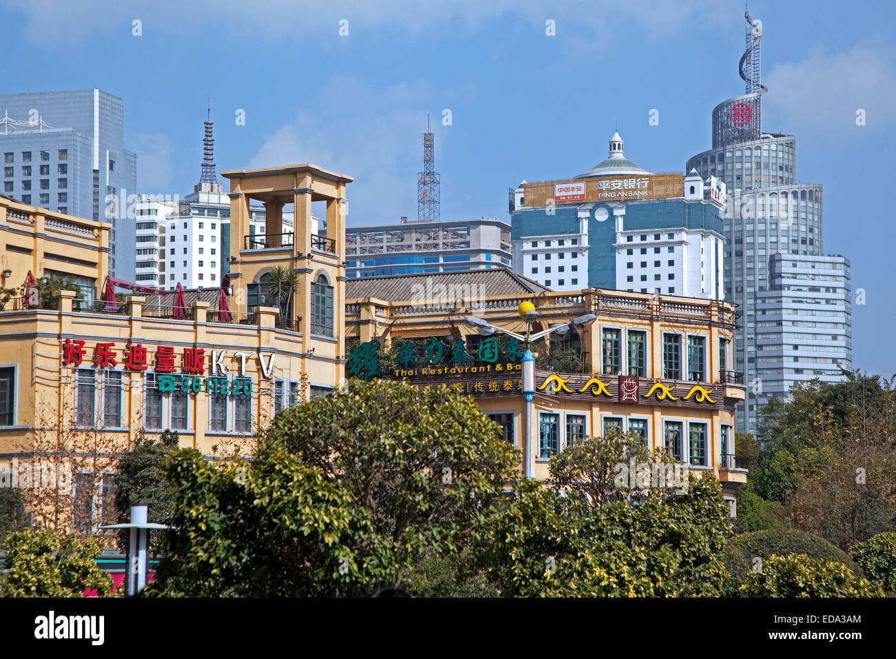 Modern highrise buildings and office blocks in the commercial city center of Kunming, Yunnan province, China - Stock Image