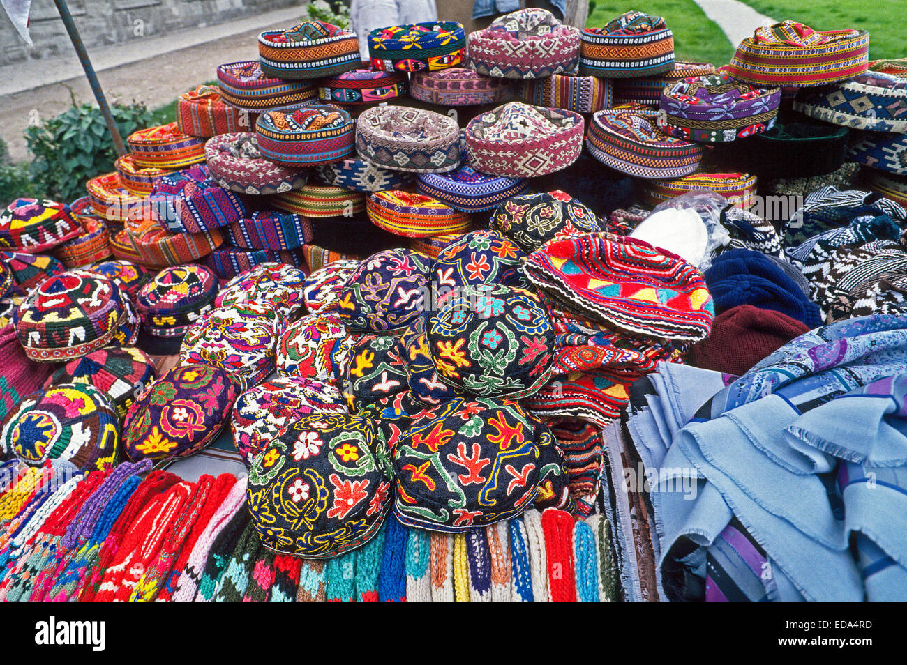 Very colorful knit caps and woven Turkish hats displayed at an outdoor market are mostly sold to tourists in Istanbul, - Stock Image