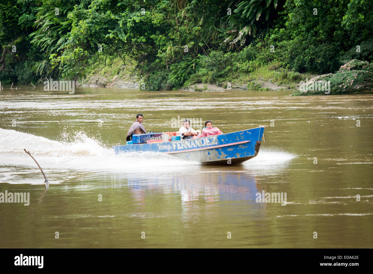 Fast Motor Launch with People on River of Amazon Region of Peru - Stock Image