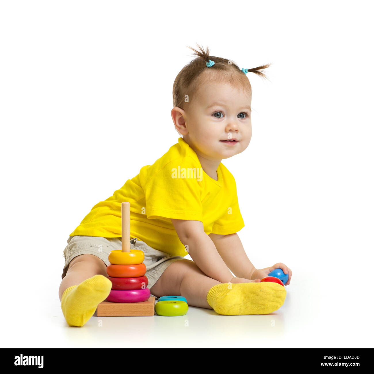 baby playing with colorful tower isolated - Stock Image