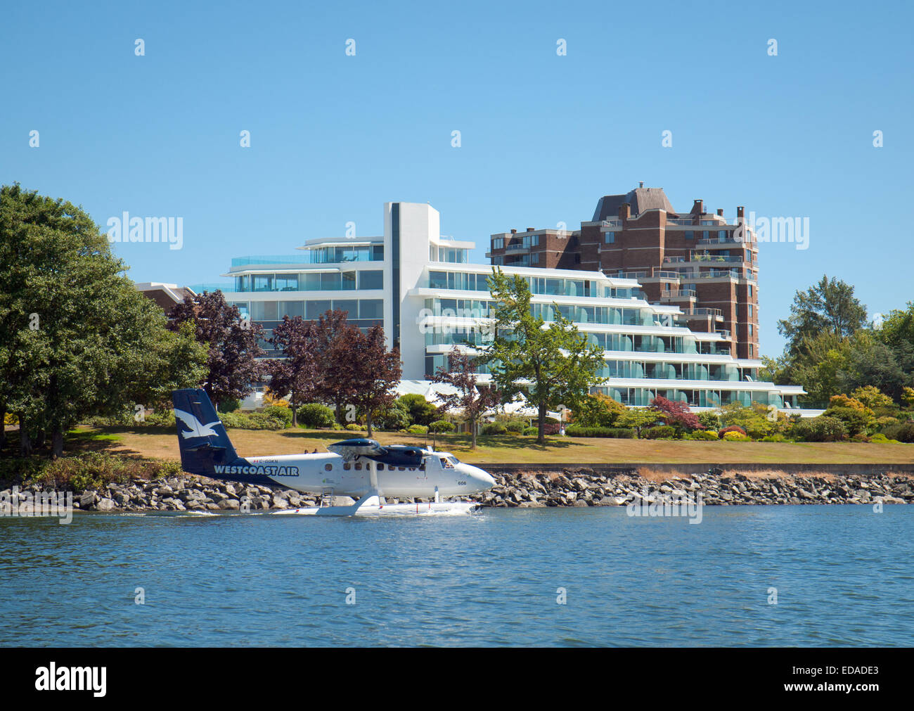 A Harbour Air DHC-6 DeHavilland Twin Otter seaplane in front of the Inn at Laurel Point in Victoria, British Columbia, - Stock Image