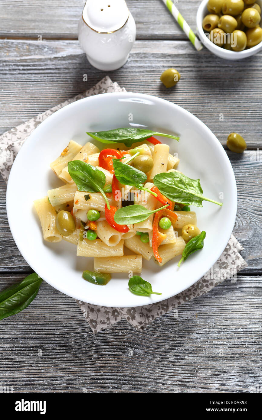 Pasta with vegetables and spinach, food - Stock Image