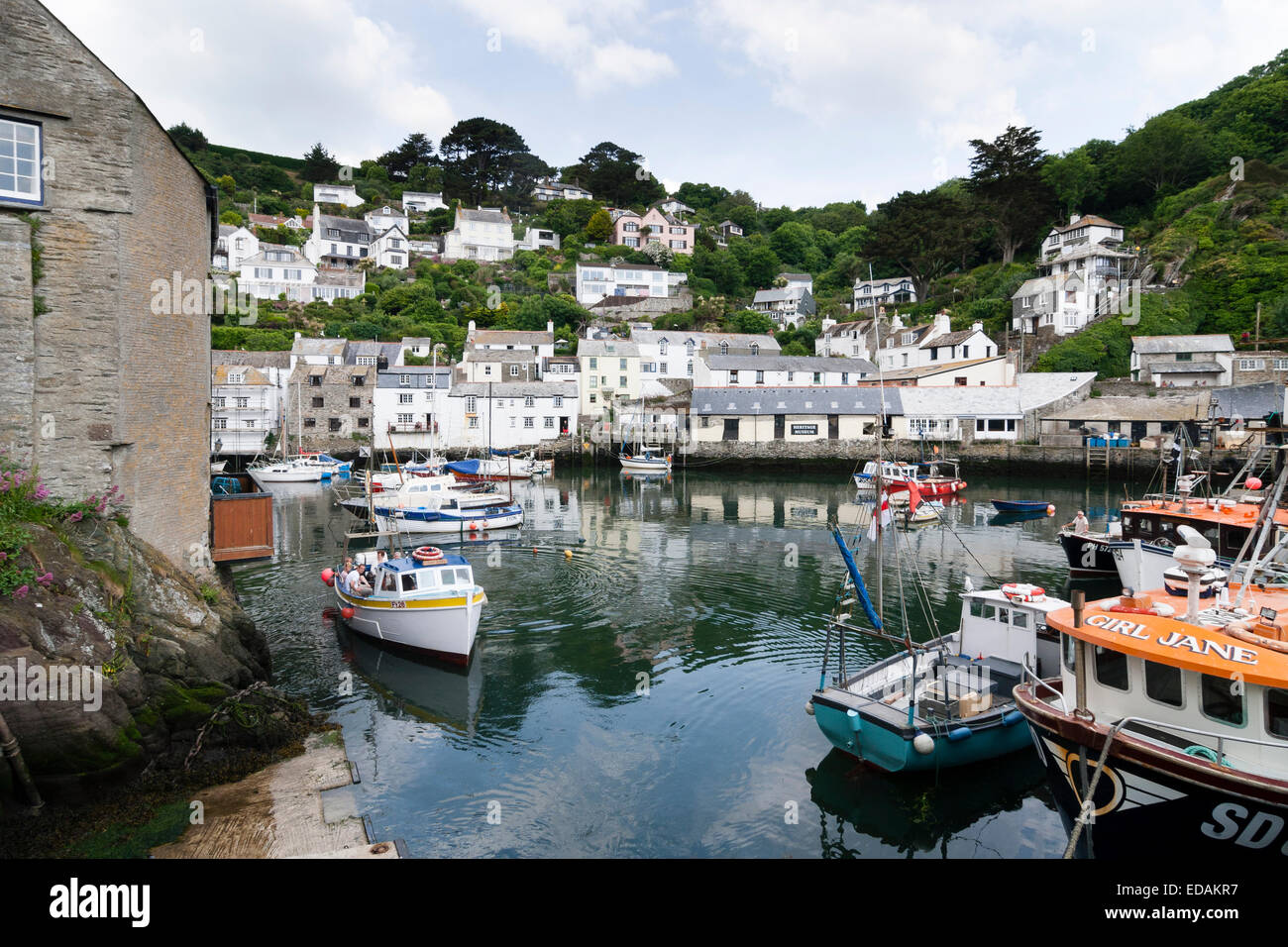 Fishing and pleasure boats in the inner harbour of Polperro, Cornwall - Stock Image