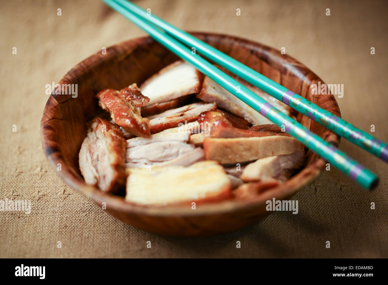 Chinese fry pork chops into small pieces and served with chopsticks