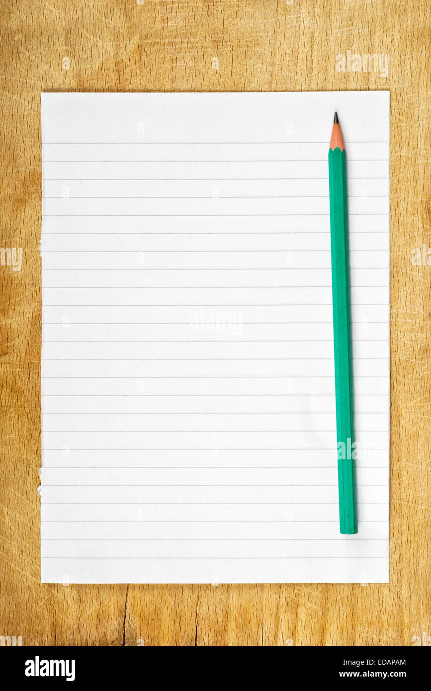 writing notes concept graphite pencil and piece of blank paper as