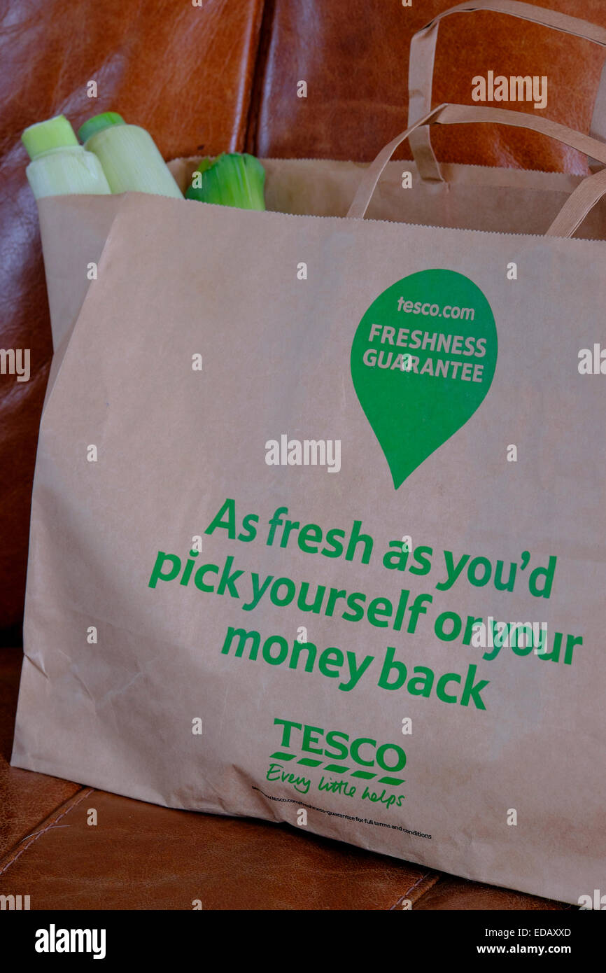 Tesco tescos recyclable brown paper carrier bag used for home delivery , good for the planet and keeping fresh produce - Stock Image