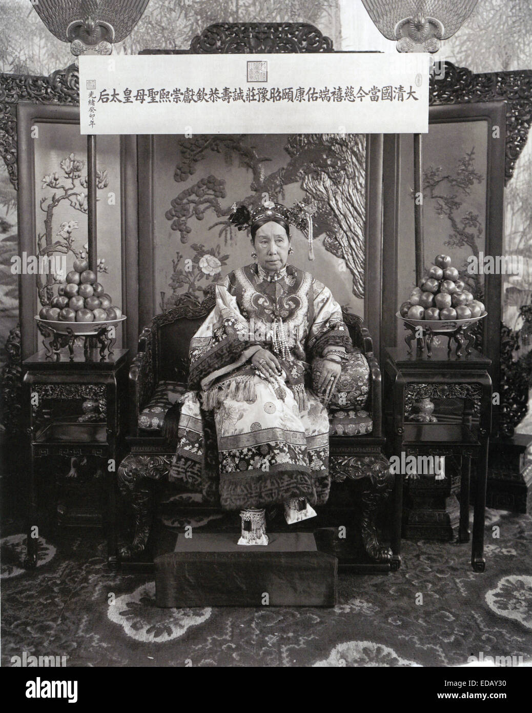 CHINESE EMPRESS DOWAGER CIXI (1835-1908)  The board above her head carries her full title - Stock Image