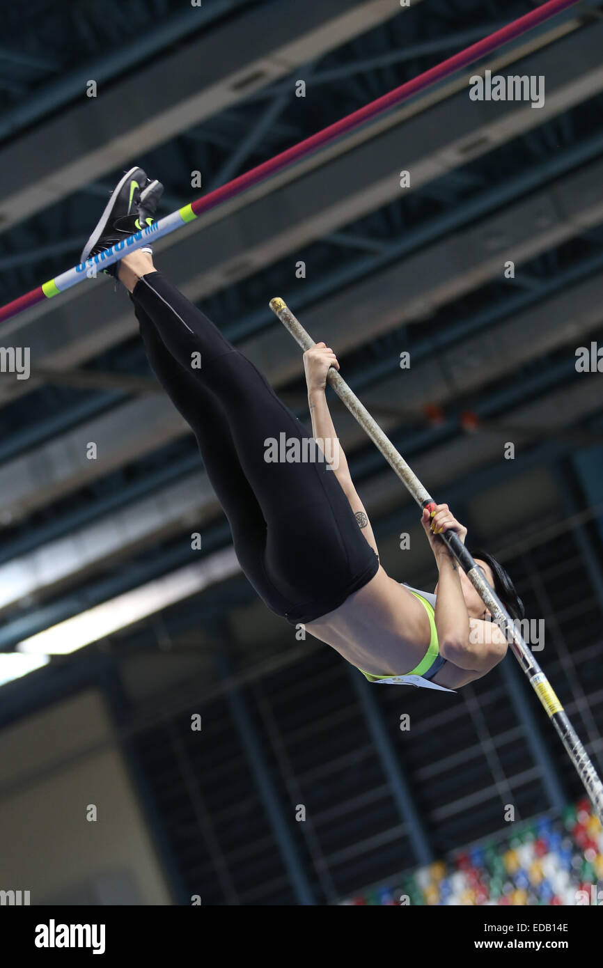 ISTANBUL, TURKEY - DECEMBER 27, 2014: Athlete Buse Arikazan pole vaulting during Athletics record attempt races - Stock Image