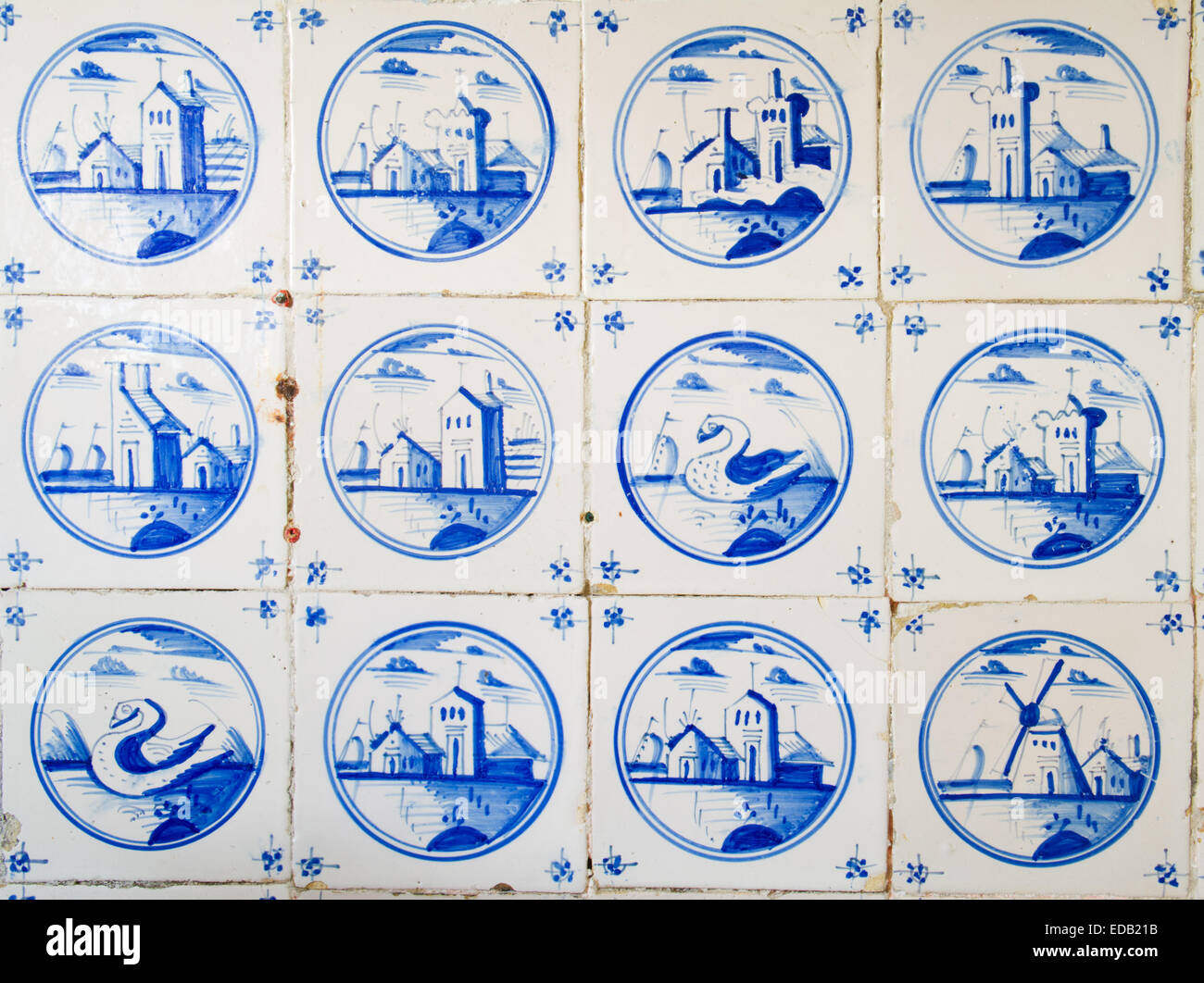 Antique dutch tiles on the kitchen wall of an old building - Stock Image