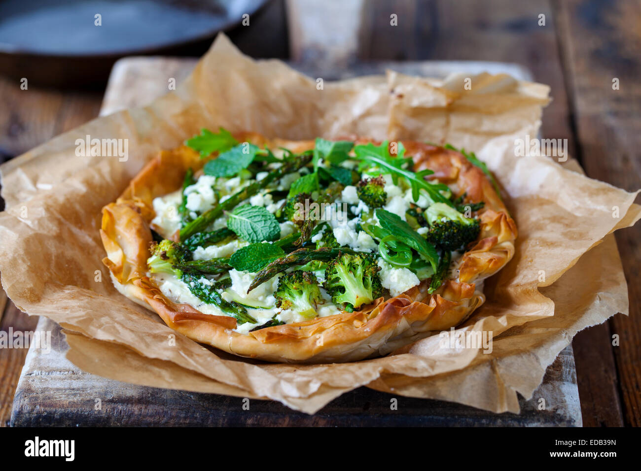 Filo pastry pie with roast green vegetable - Stock Image