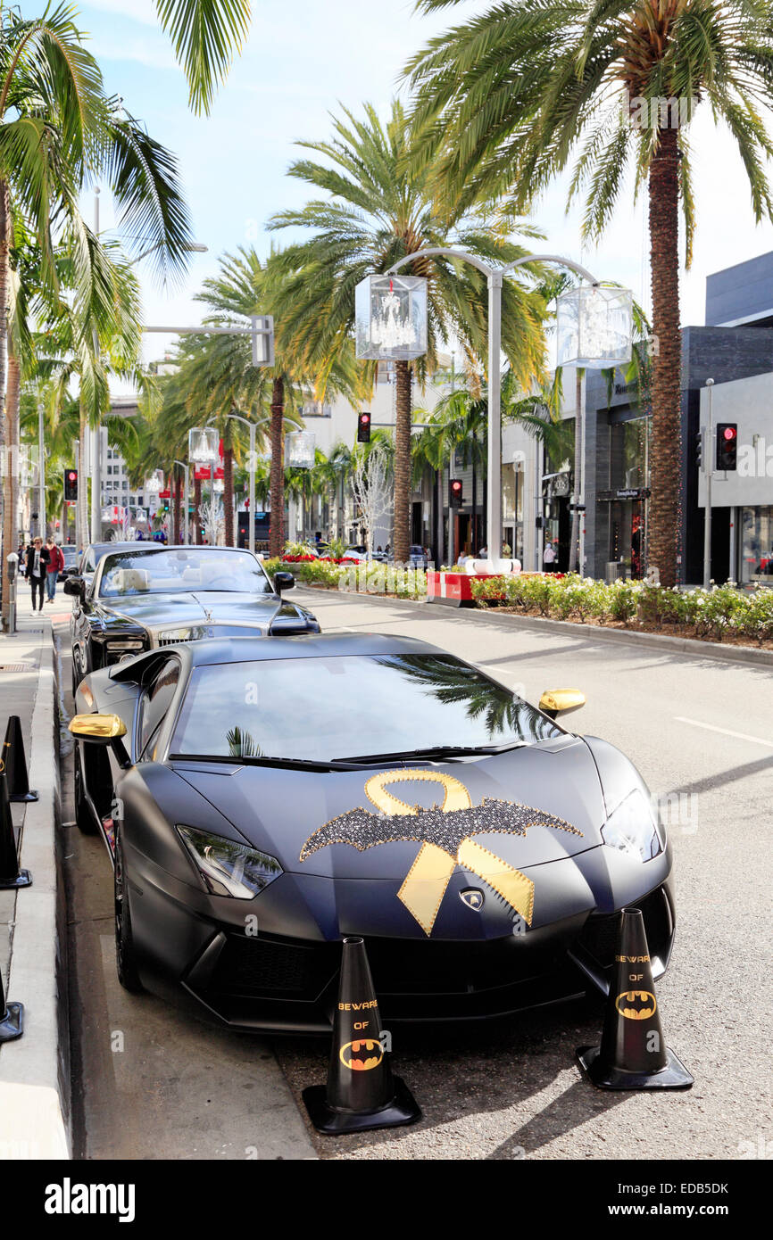 batman decorated lamborghini parked on rodeo drive, beverly hills