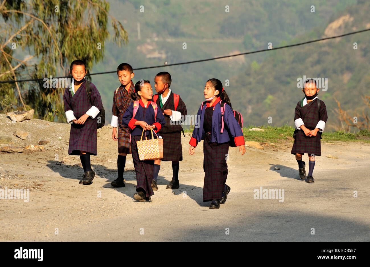 Kids wearing traditional school uniforms, Trongsa, Bhutan - Stock Image