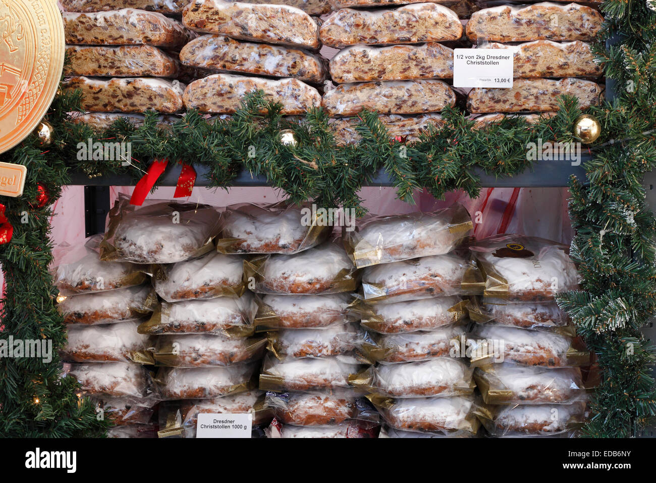 Christmas Stollen on Christmas market in Dresden, Germany - Traditional Sweet Fruit Loaf with Icing Sugar - Stock Image