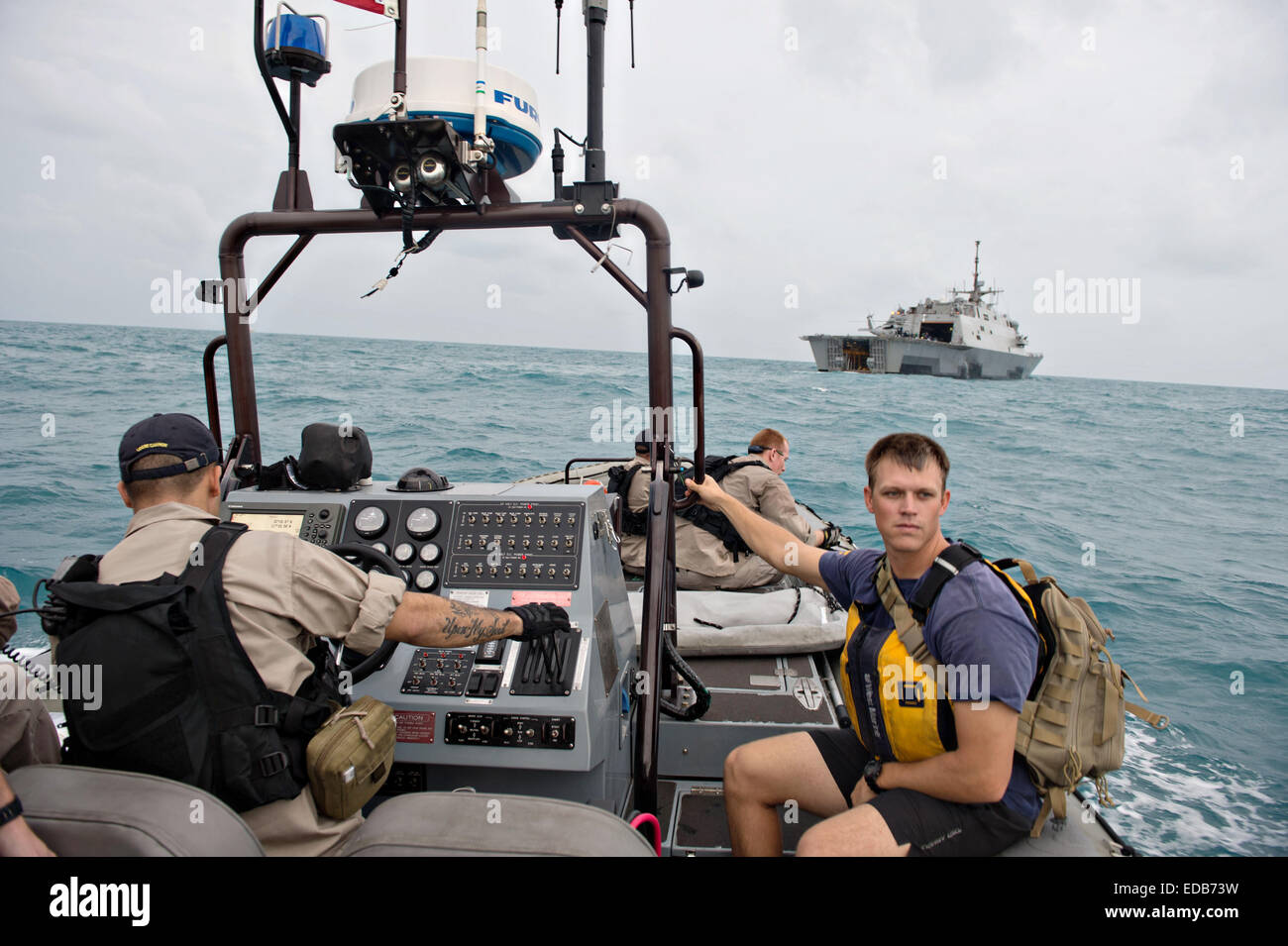 US Navy sailors from the littoral combat ship USS Fort Worth prepare to launch a Tow Fish side scan sonar system - Stock Image