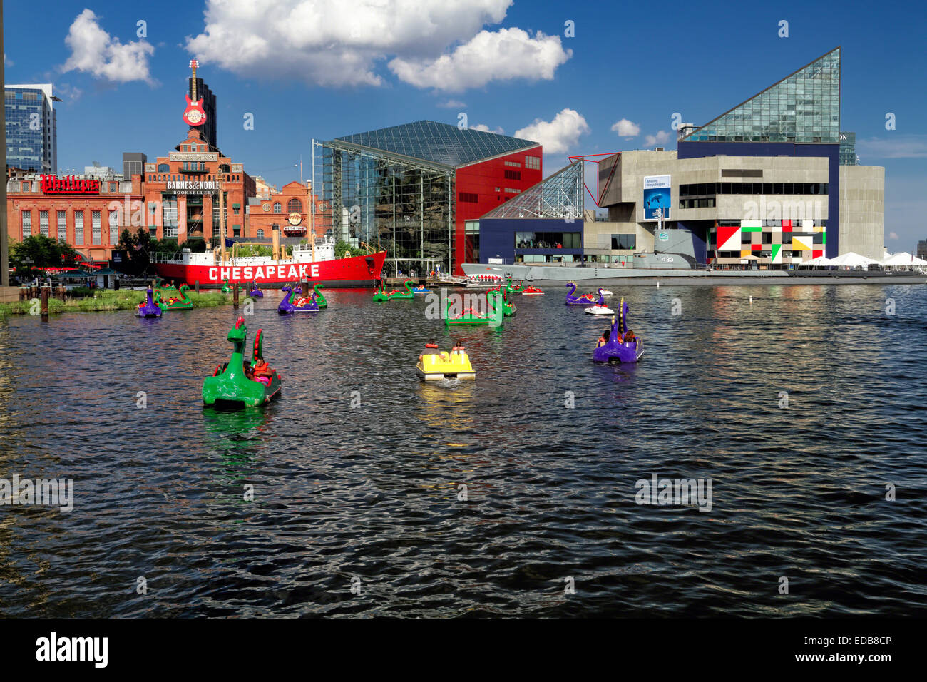Baltimore Inner Harbor View with Paddle Boats, The Power Plant Mall and the National Aquarium, Maryland - Stock Image