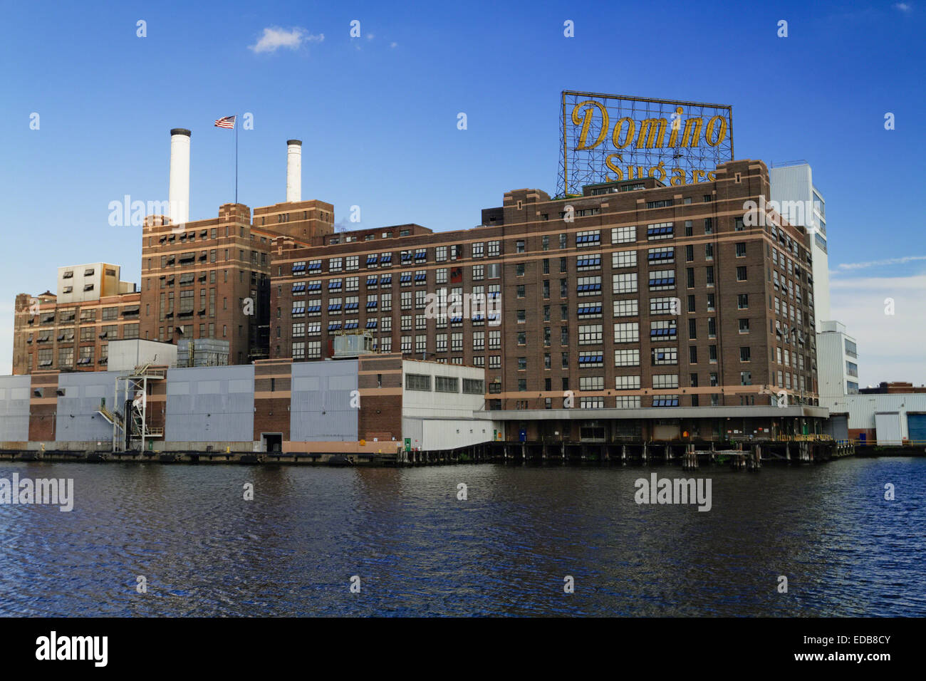 Low Angle View of an Industrial Building in a Bay, Domino Sugars, Baltimore, Maryland - Stock Image