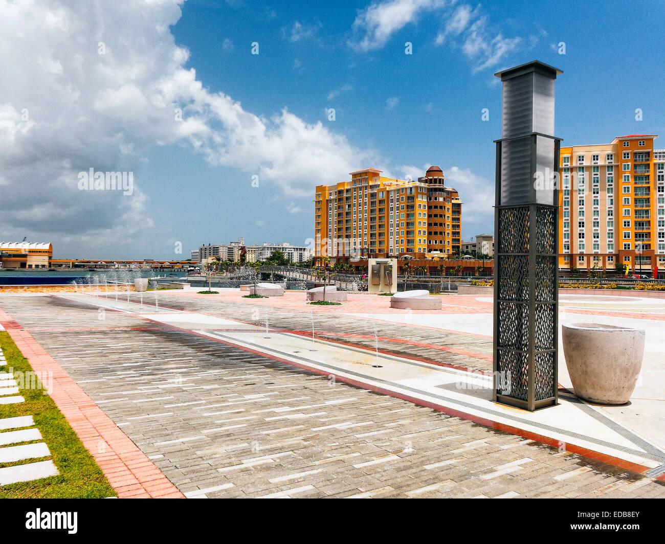 High Rise Buildings Along The Waterfront, Bahia Urbana Park, San Juan, Puerto Rico - Stock Image