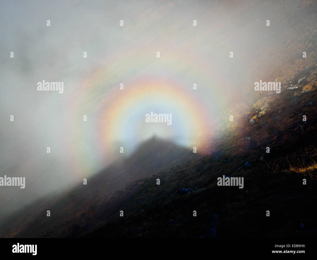 Optical phenomenon of 'glory' or 'Buddha's light' in the Nepal Himalaya - Stock Image