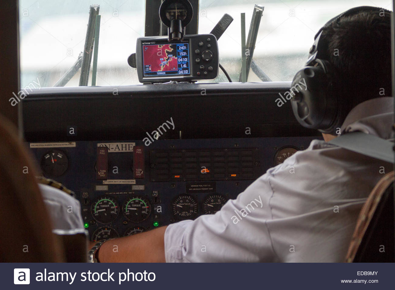 Pilot sitting in airplane cockpit - nepal - Stock Image