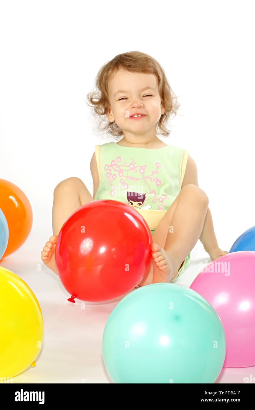 Little girl and balloons. - Stock Image