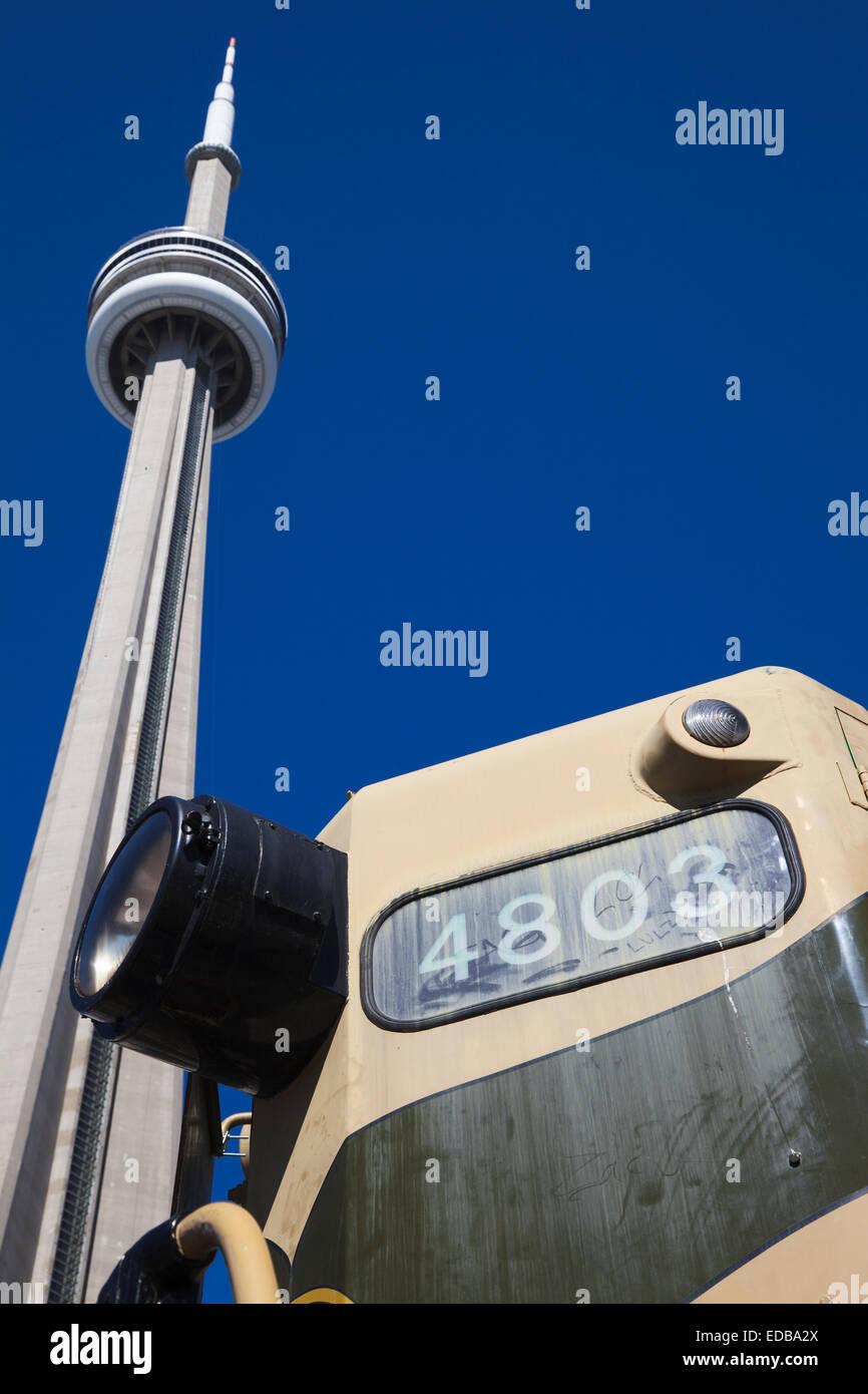 CN Tower Toronto and vintage railway locomotive - Stock Image