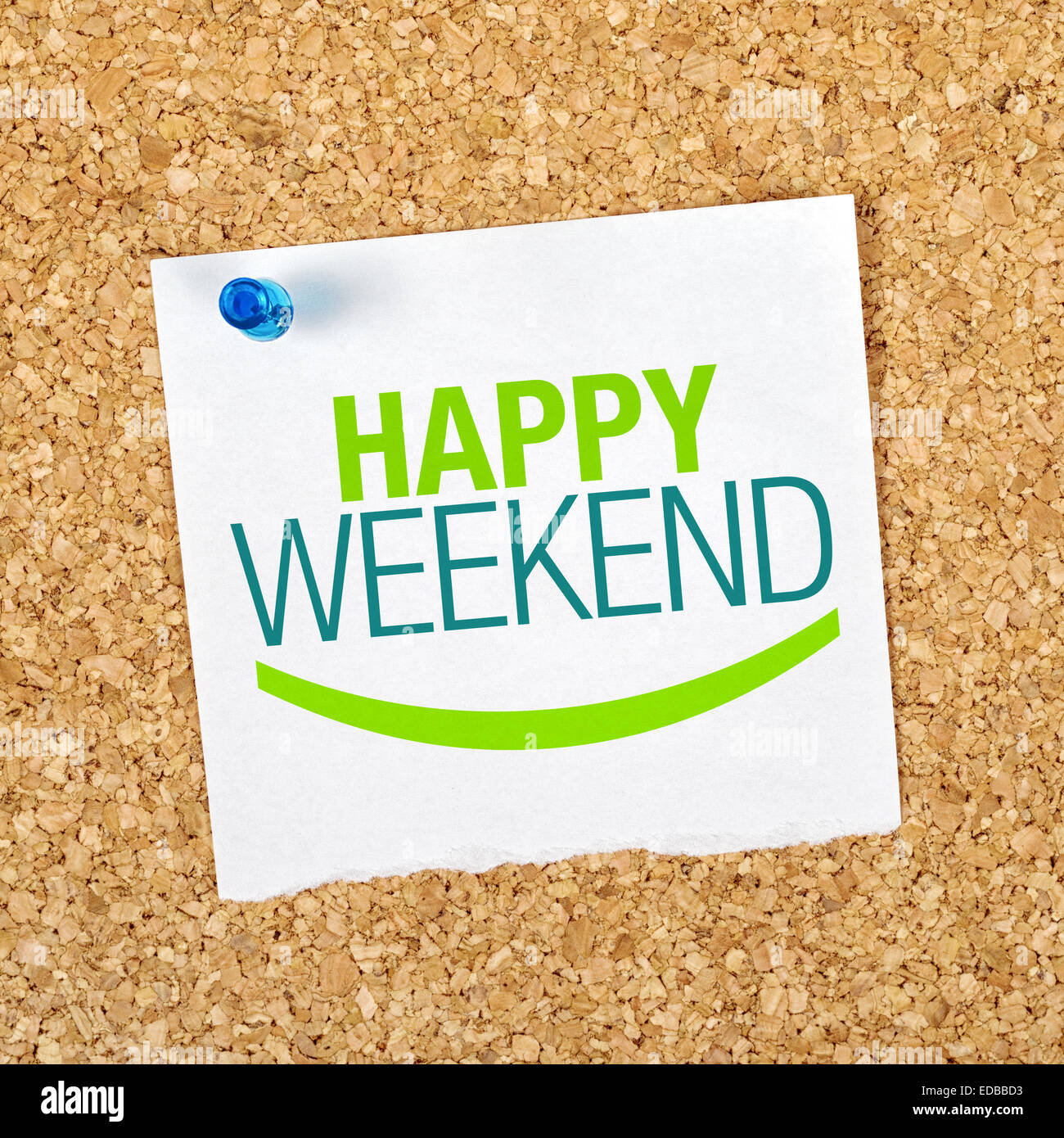 Happy Weekend Reminder Note Pinned to a Cork Memory Bulletin Board. - Stock Image