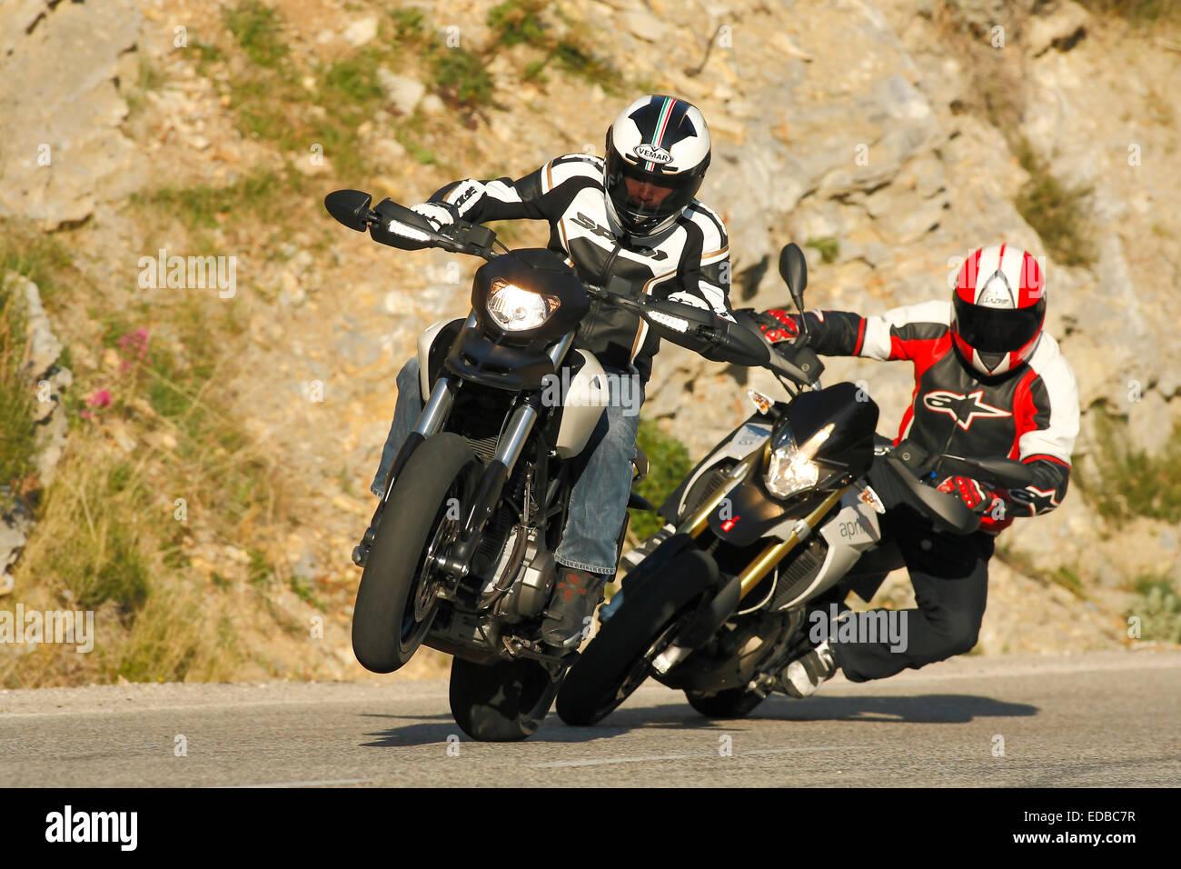 Motorcycles, Ducati Hypermotard 796, Aprilia Dorsoduro, driving - Stock Image