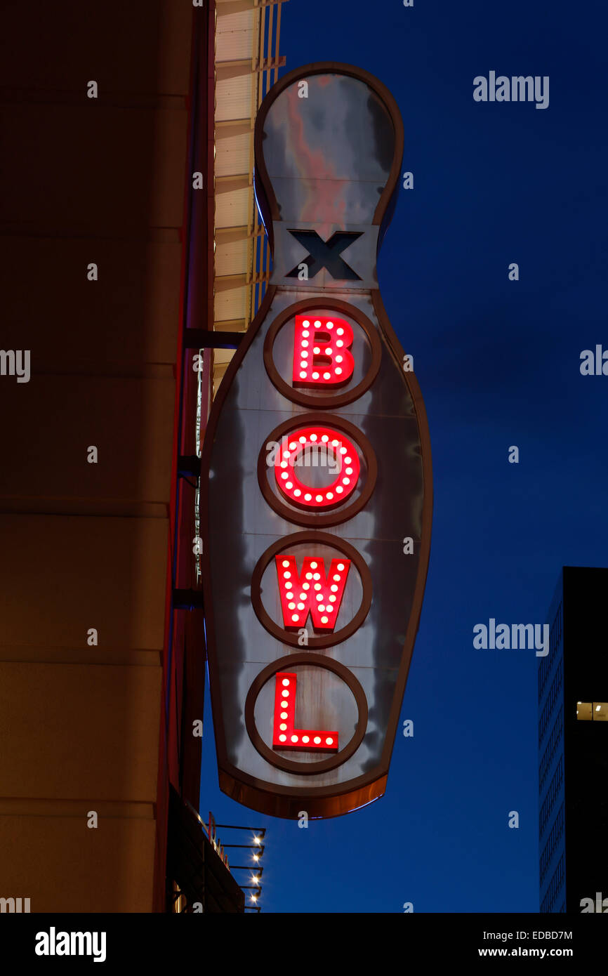 Neon light in the shape of a bowling pin, 16th Street Mall, Denver, Colorado, United States - Stock Image