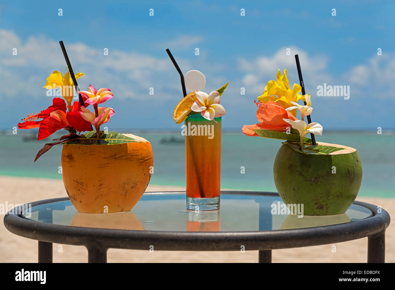 Cocktails served in coconuts, Mauritius - Stock Image
