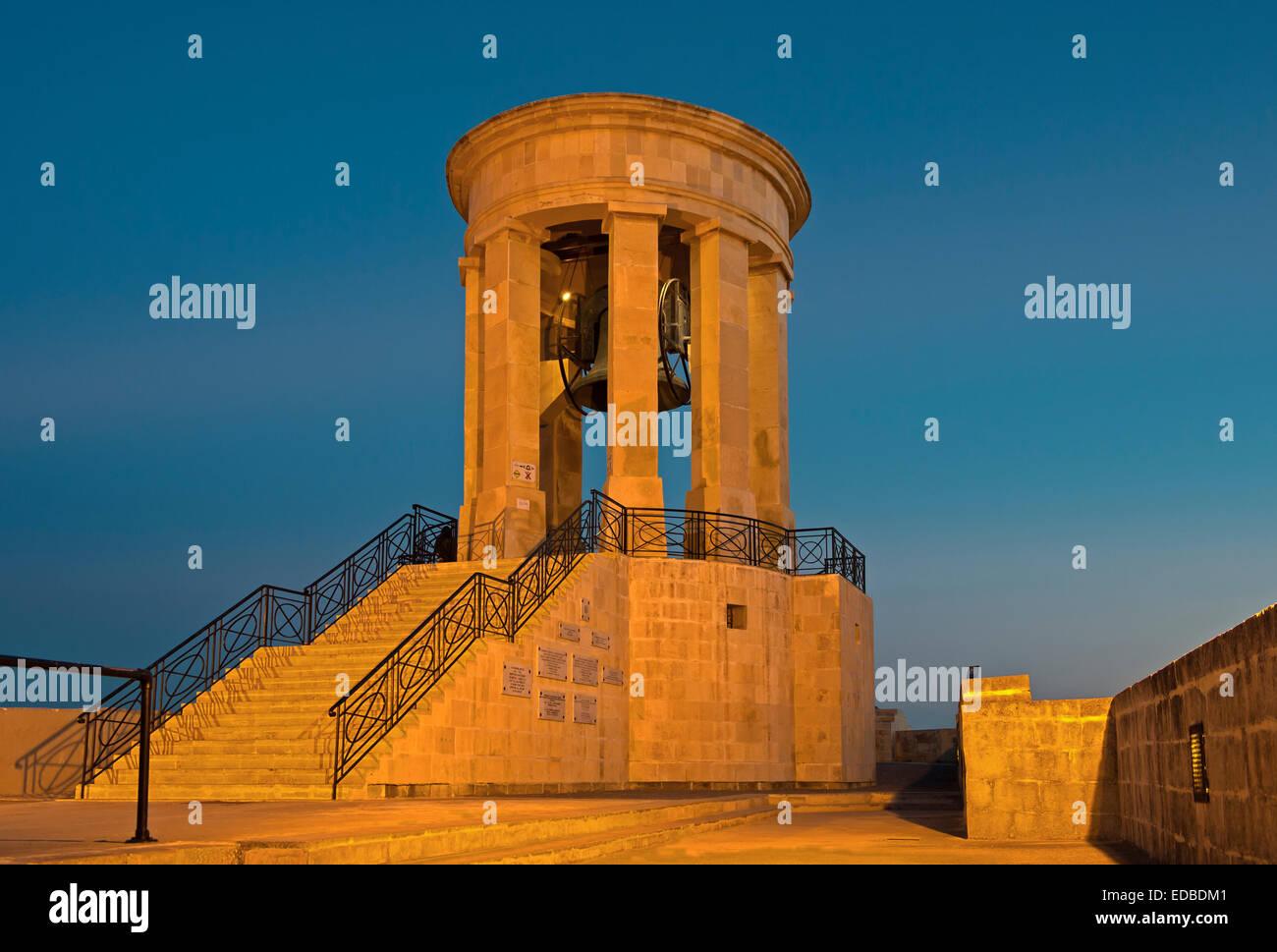 Siege Bell Memorial, at night, Valletta, Malta - Stock Image
