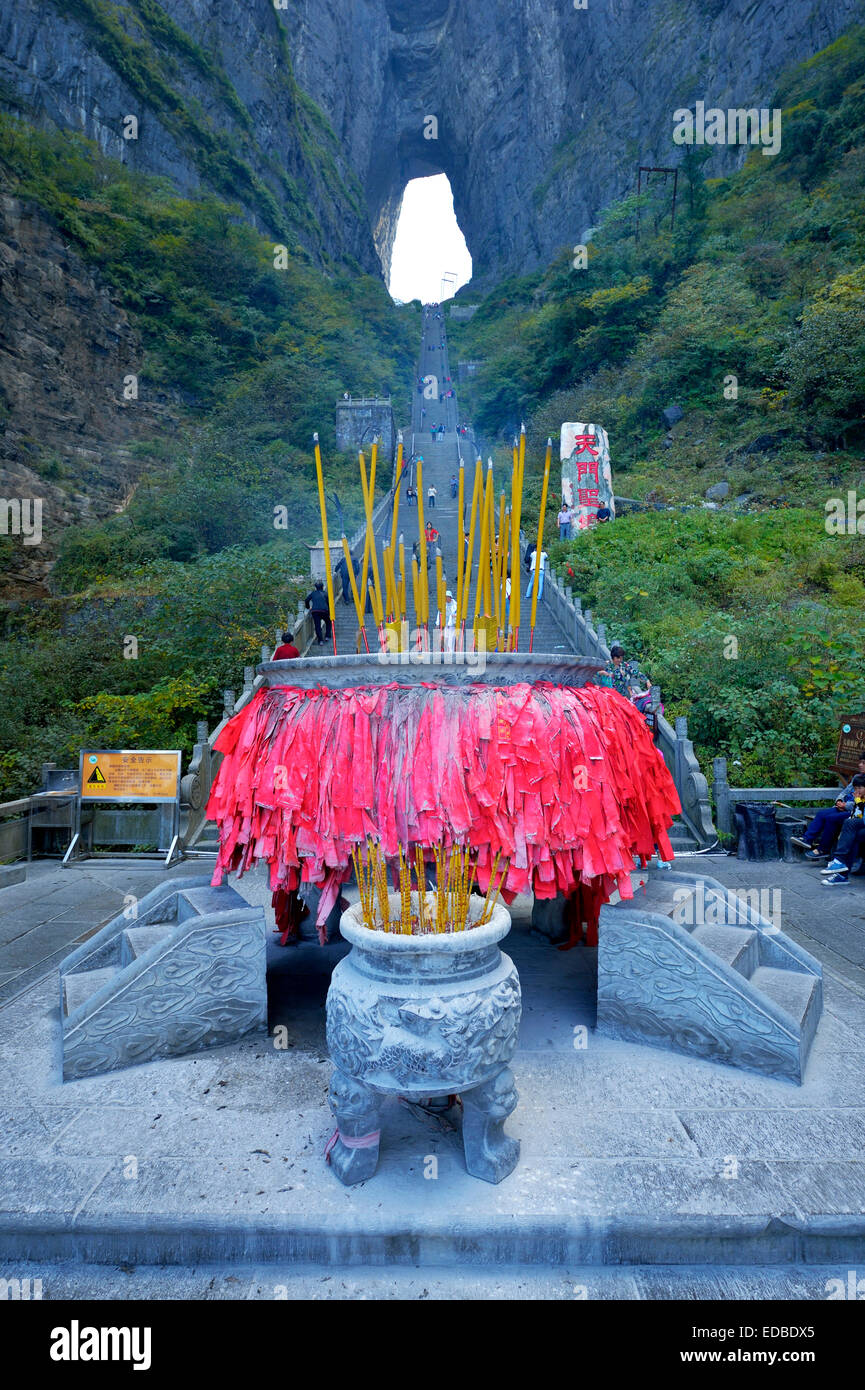 Heaven's Gate with prayer flags at the front, Tianmen Cave, the world's largest natural water eroded cave, - Stock Image