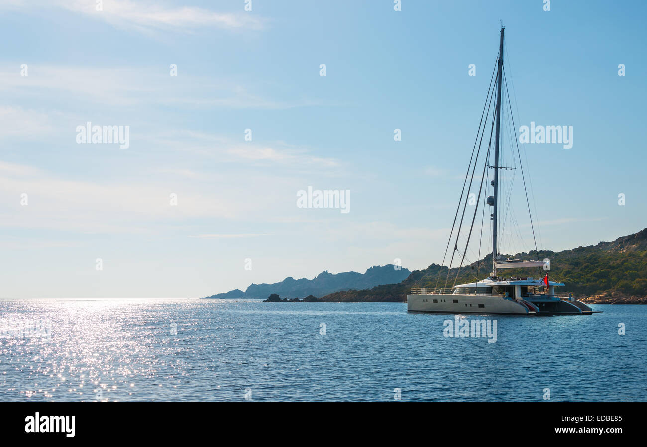 Sailing yacht, catamaran, sailing boat in the sea off Bonifacio, Corsica, France - Stock Image