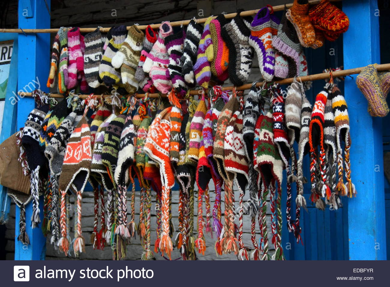 Nepalese wool hats and gloves on Himalayan trail Stock Photo ... 80b8f4cb606
