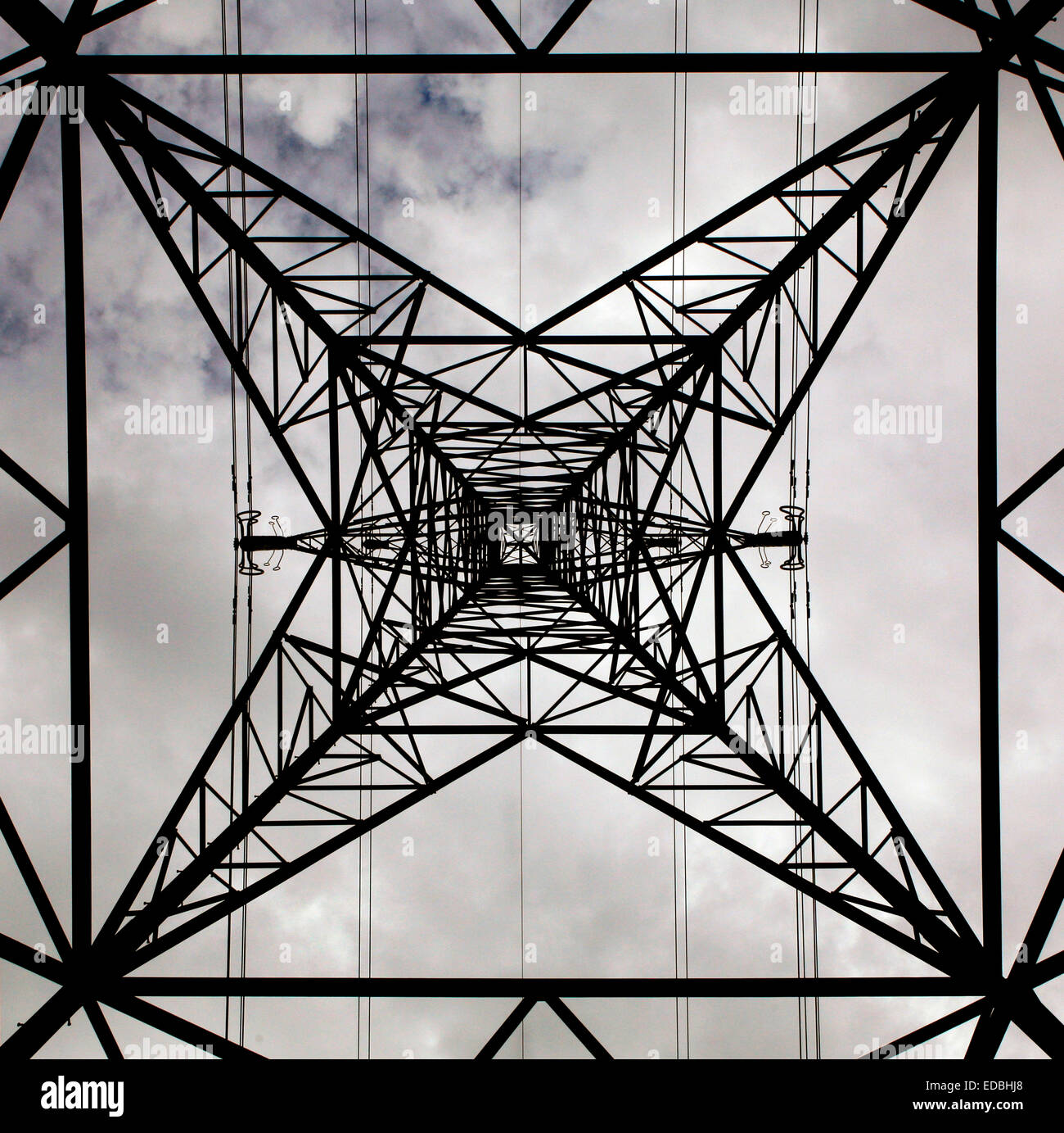 Picture shows an electricity pylon photographed from beneath. - Stock Image