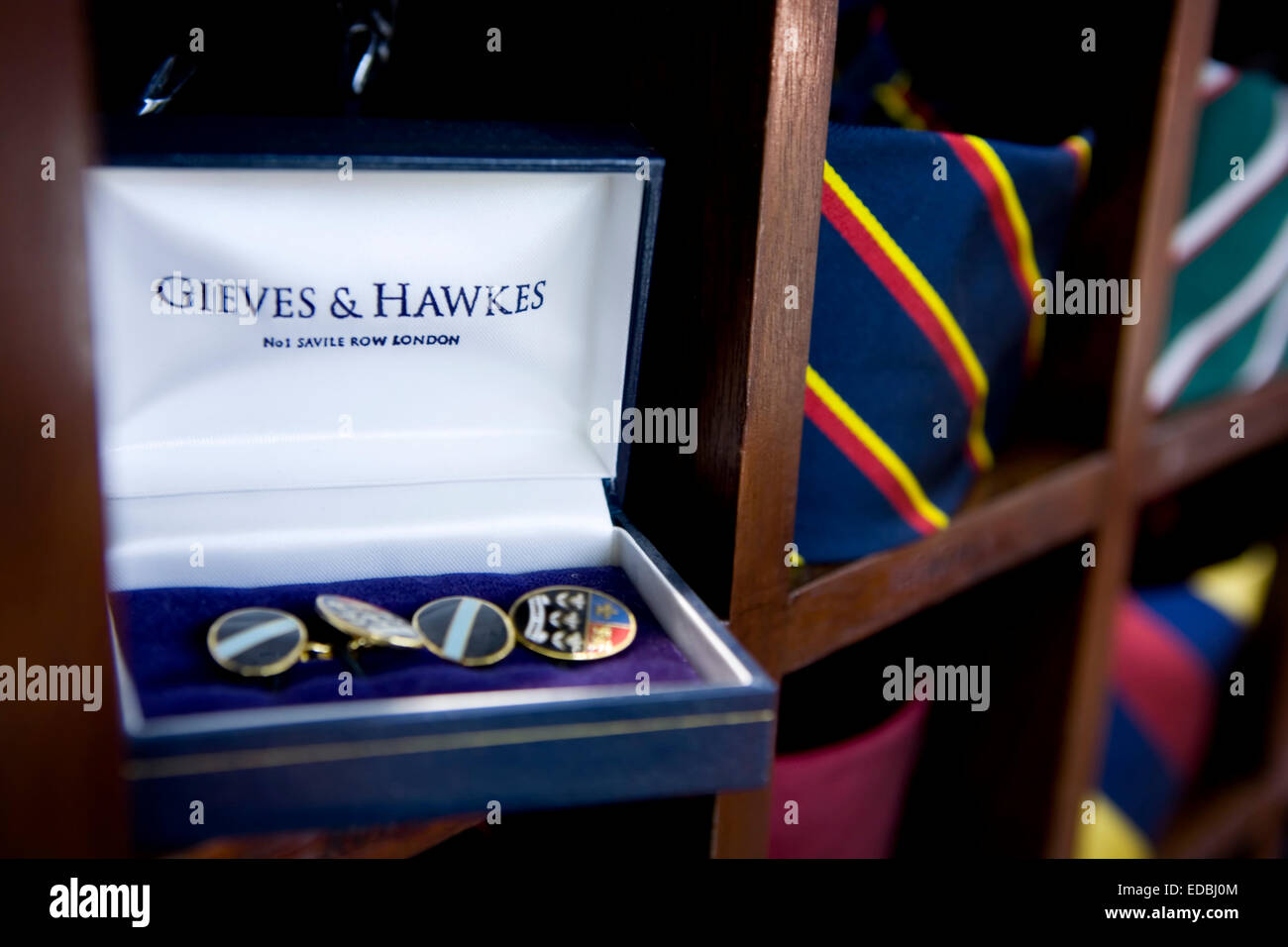 Close-up picture of accesories and ties in the flagship Gieves & Hawkes store on Savile Row, London. - Stock Image