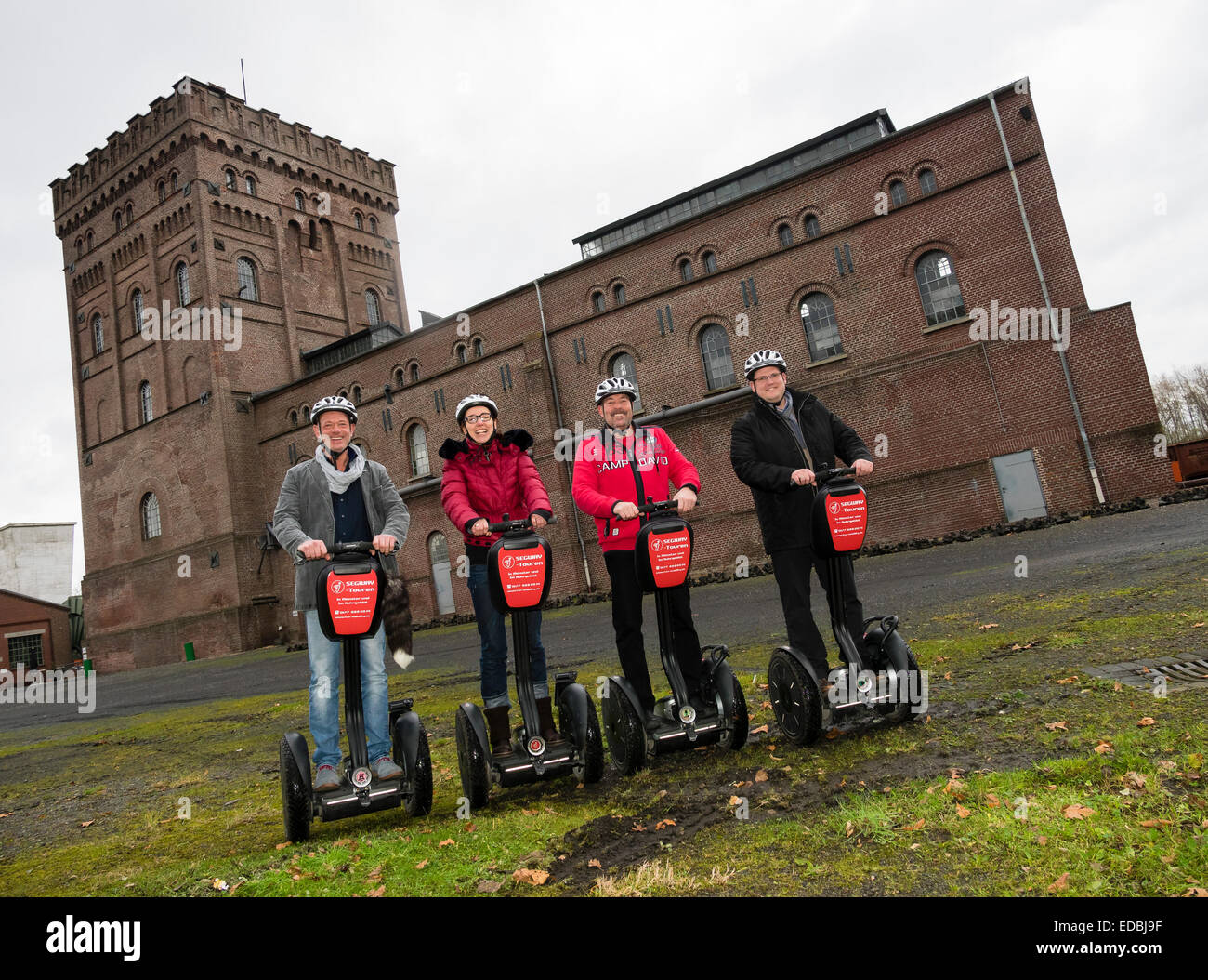 "Segway drivers move in front of the industrial museum ""Zeche Hannover"" in the Ruhr area to promote Segway tours Stock Photo"