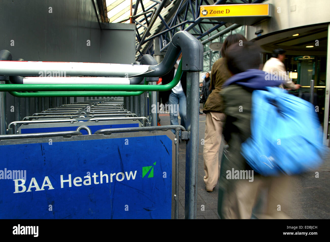 Picture shows: A passenger going towards the check-in area at Heathrow Airport. - Stock Image