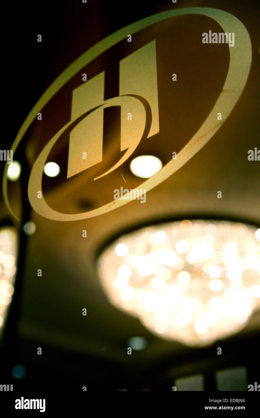 The Hilton logo on a hotel's entrance - Stock Image