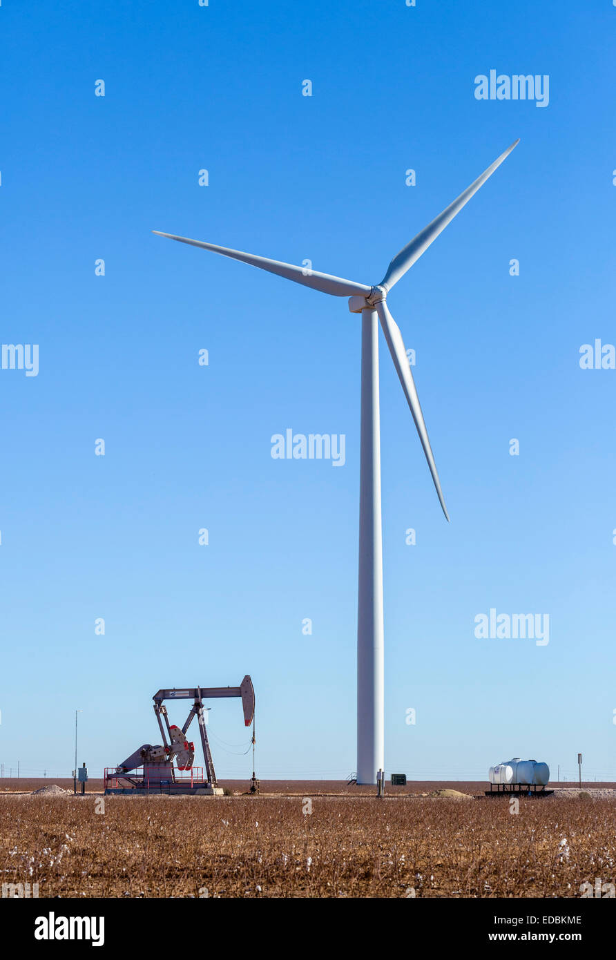 Oil well next to a wind turbine outside Midland, Texas, USA - Stock Image