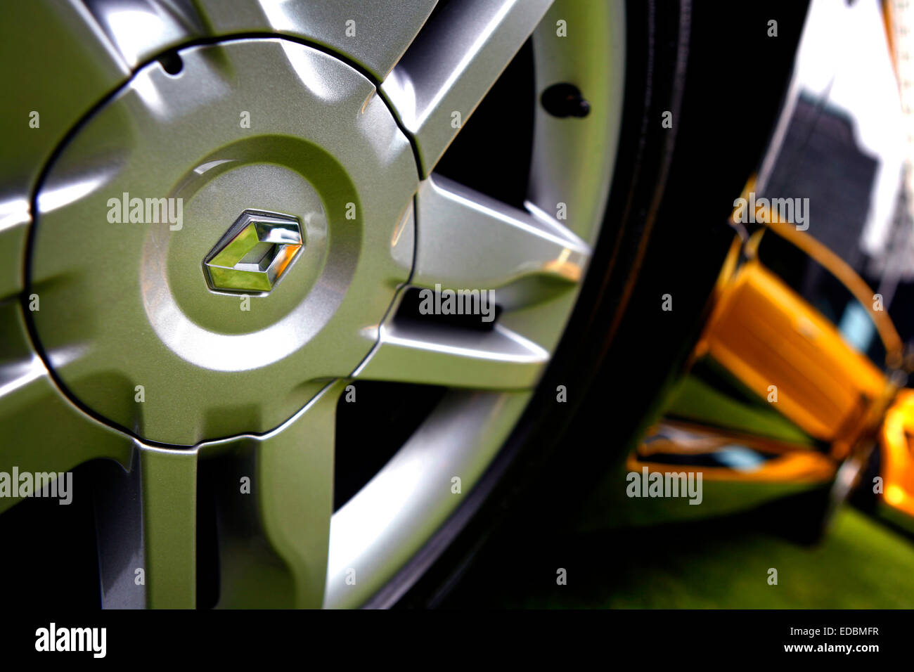 The alloy wheels of a highly polished black Renault in Central London. - Stock Image