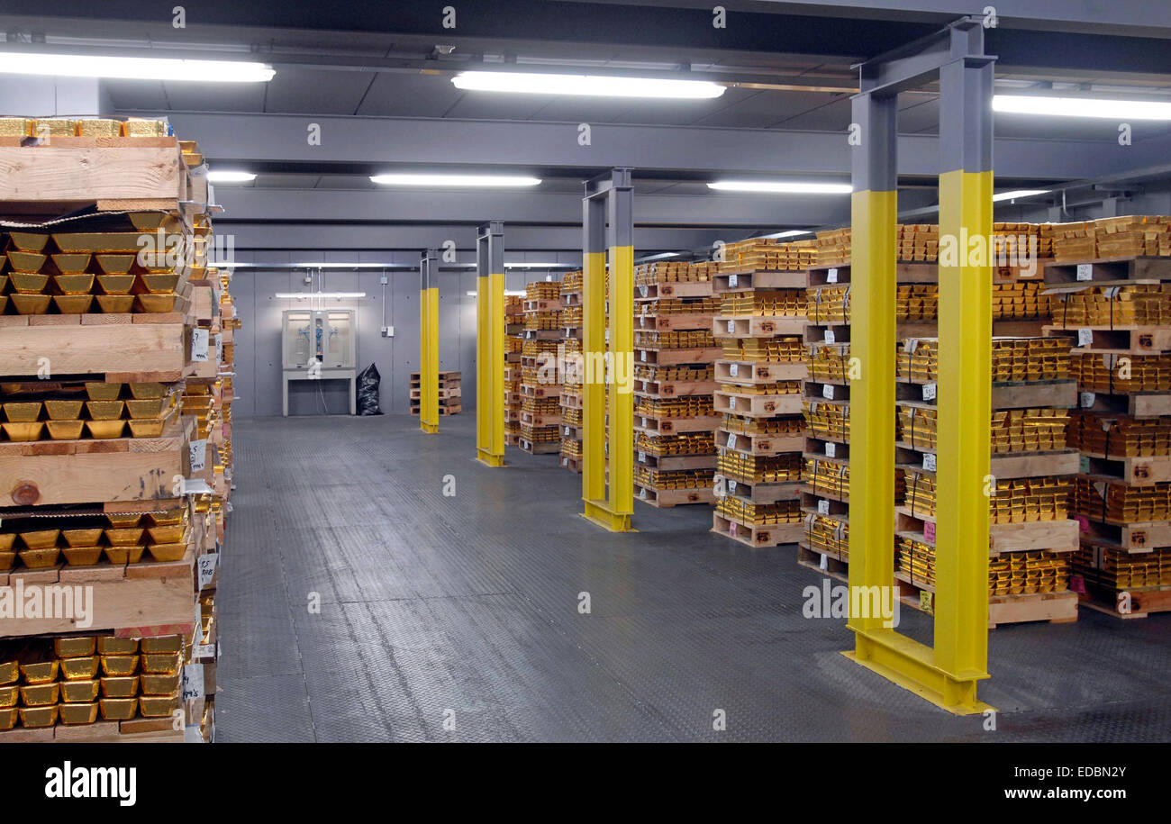 Gold Bullion stacked in a safehouse. - Stock Image