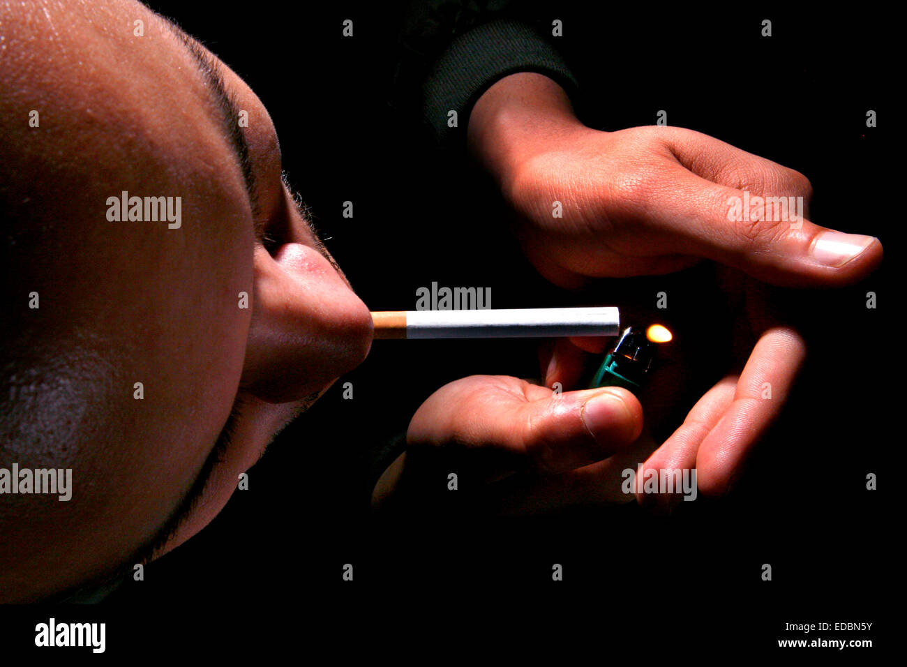 A man smoking a cigarette, photographed from above - Stock Image