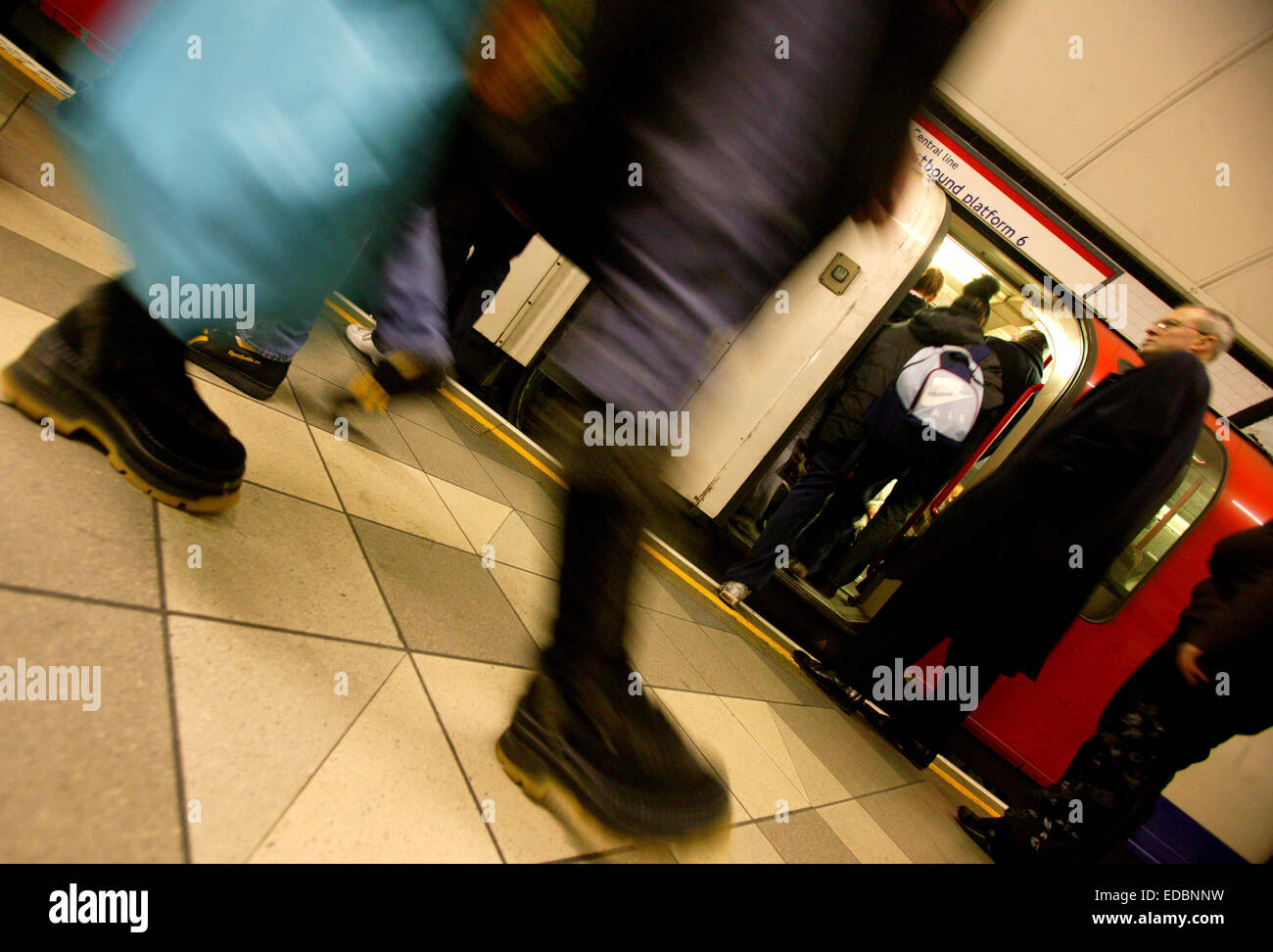 Passengers boarding a London Underground central line train at Bank station. - Stock Image