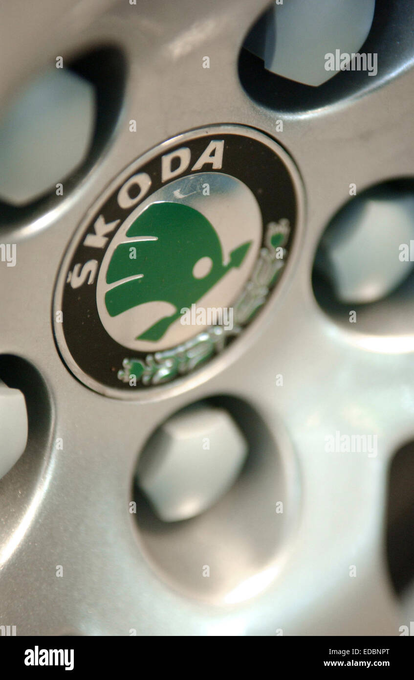 Alloy wheel showing the Skoda emblem. - Stock Image